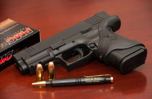 Logo Photo of Firearm and Gary B. Wells, Attorney at Law pen