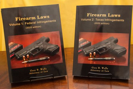 Photo of Firearm Books, Vols. 1 (Federal Law) and Vol. 2 (Texas Law)